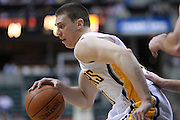 March 13, 2012; Indianapolis, IN, USA; Indiana Pacers power forward Tyler Hansbrough (50) dribbles the ball around the back court against the Portland Trail Blazers at Bankers Life Fieldhouse. Indiana defeated Portland 92-75. Mandatory credit: Michael Hickey-US PRESSWIRE