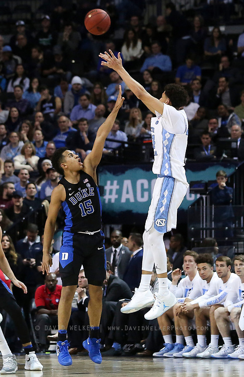 North Carolina forward Justin Jackson (44) shoots a ball over Duke guard Frank Jackson (15) during the semifinals of the 2017 New York Life ACC Tournament at the Barclays Center in Brooklyn, N.Y., Friday, March 10, 2017. (Photo by David Welker, theACC.com)