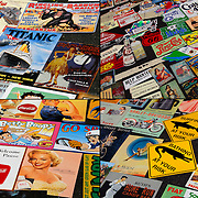 Collage of four photographs of different  rows of signs / reproduction posters on table in flea market for sale