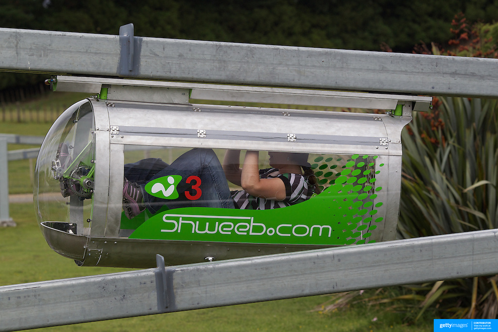 A visitor to AgroVentures powers around the Schweeb pedal powered mono rail. AgroVentures Adventure Park,  Paradise valley road, Rotorua. .Agroventures  attractions include has the world's only Shweeb, a pedal powered mono rail, Agrojet, a jet boat sprint experience, Swoop  swing from 40m towards the earth at 130kmph and the Southern Hemispheres' only Freefall Xtreme, wind tunnel. Rotorua, New Zealand,, 10th December 2010. Photo Tim Clayton
