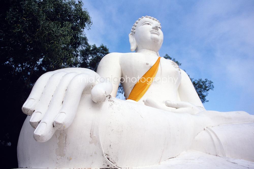 White Buddha statue, with gold sash, Northern Thailand.
