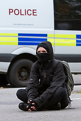 © Licensed to London News Pictures . FILE PHOTO DATED 14/07/2012 of a Black Bloc protester at a demonstration in Bristol as reports circulate that black bloc tactics may be employed by protesters seeking to demonstrate during the funeral of former British Prime Minister Margaret Thatcher . Photo credit : Joel Goodman/LNP