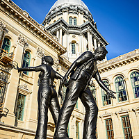 Picture of Illinois Police Officers Memorial in Springfield Illinois. The statue is located outside of the Illinois State Capitol building and created in 1990 by sculptor Keith Knoblock.