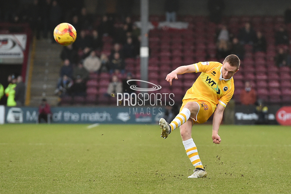Shane Ferguson (18) Millwall FC midfielder kicks forward during the EFL Sky Bet League 1 match between Scunthorpe United and Millwall at Glanford Park, Scunthorpe, England on 17 December 2016. Photo by Ian Lyall.