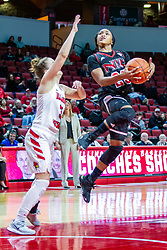 NORMAL, IL - November 20:  Myia Starks with an aerial shot defended by Mary Compton during a college women's basketball game between the ISU Redbirds and the Huskies of Northern Illinois November 20 2019 at Redbird Arena in Normal, IL. (Photo by Alan Look)
