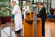 The Rev. Lee Hagan, LCMS Missouri District president, prays after installing the Rev. Dr. Gregory P. Seltz as executive director of the Lutheran Center for Religious Liberty at a Service of Installation at the International Center of The Lutheran Church–Missouri Synod on Tuesday, Aug. 22, 2017, in St. Louis. LCMS Communications/Erik M. Lunsford