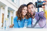 Portrait of man taking selfie with his beautiful girlfriend