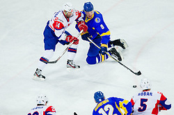 Matej Hocevar of Slovenia vs Andri Mikhnov of Ukraine during ice-hockey match between Slovenia and Ukraine at IIHF World Championship DIV. I Group A Slovenia 2012, on April 19, 2012 in Arena Stozice, Ljubljana, Slovenia. (Photo by Vid Ponikvar / Sportida.com)