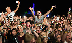 © Licensed to London News Pictures. 28/08/2015. Reading Festival, UK.  Festival goers watch Mumford and Sons performing at Reading Festival 2015 28 August 2015 Day 1.  Photo credit: Richard Isaac/LNP