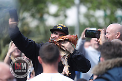 Manchester UK 11.06.2017 A man eats part of  pigs  head during a demo in Manchester city centre today the demo which was organised by UK Against Hate lasted all day and  400 police officers had to keep rival groups apart