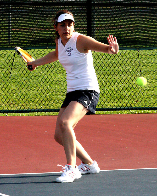 Chautauqua Lake's Joni Keating playing first singles returns a volley 9-23-09 photo by Mark L. Anderson