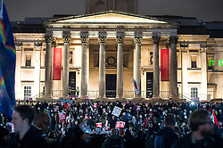 © Licensed to London News Pictures. 05/11/2015. London, UK. Demonstrators gather outside the National Portrait Gallery in Trafalgar Square before An anti-capitalist  protest organised by the group Anonymous outside Parliament in Westminster on bonfire night 05, November 2015. Bonfire night, also known as Guy Fawkes night, is an annual commemoration of when Guy Fawkes, a member of the Gunpowder Plot, was arrested for attempting to blow up the House of Lords at parliament.   Photo credit: Ben Cawthra/LNP