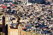 Fez, Morocco - 3rd FEBRUARY 2018 - Close-up of the walls surrounding Fez medina with clustered rooftops of the old city in the background, Middle Atlas Mountains, Morocco.