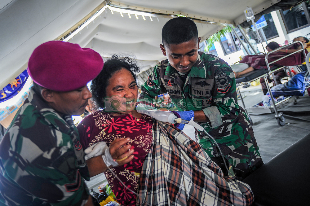 October 4, 2018 - Palu, Central Sulawesi, Indonesia - A resident seen reviving treatment at Anutapura Hospital after the earthquake..A deadly earthquake measuring 7.7 magnitude and the tsunami wave caused by it has destroyed the city of Palu and much of the area in Central Sulawesi. According to the officials, death toll from devastating quake and tsunami rises to 1,347, around 800 people in hospitals are seriously injured and some 62,000 people have been displaced in 24 camps around the region. (Credit Image: © Hariandi Hafid/SOPA Images via ZUMA Wire)