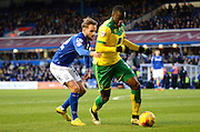 Sebastien Bassong shields the ball from Andy Shinnie during the Sky Bet Championship match between Birmingham City and Norwich City at St Andrews, Birmingham, England on 31 January 2015. Photo by Alan Franklin.