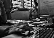 Camopi, Guyane, 2015.<br /> <br /> P&ocirc;le emploi. Citoyens fran&ccedil;ais, les habitants de Camopi en ont les m&ecirc;mes droits et les m&ecirc;mes devoirs. L&rsquo;obtention du Revenu de Solidarit&eacute; Active ne les dispense pas de leurs obligations d&rsquo;insertion. R&eacute;guli&egrave;rement, ils se d&eacute;placent depuis leurs &eacute;carts sur le fleuve jusqu&rsquo;au bureau d&eacute;di&eacute; de la mairie pour effectuer des recherches sur d&rsquo;hypoth&eacute;tiques emplois locaux et maintenir leur droit &agrave; l&rsquo;allocation.