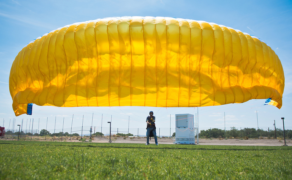 "mkb060917h/metro/Marla Brose --  Mark Stevens, a student paraglider from Ribera, N.M., waits for breeze to help him practice flying the wing of his paraglider at Balloon Fiesta Park in Albuquerque, N.M., June 9, 2017. ""When you are 55, you can still learn new things,"" Stevens said. He said that he hopes to paraglide off the top of Sandia Peak after completing his training. (Marla Brose/Albuquerque Journal)"