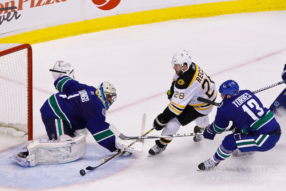 June 15, 2011; Vancouver, BC, CANADA; Vancouver Canucks goalie Roberto Luongo (1) saves a shot from Boston Bruins left wing Mark Recchi (28) during the second period of game seven of the 2011 Stanley Cup Finals at Rogers Arena. Boston defeated Vancouver 4-0. Mandatory Credit: Jason O. Watson / US PRESSWIRE