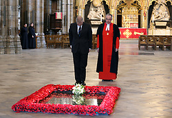 The Duke of York watched by Very Rev Dr.John Hall, Dean of Westminster, lays flowers at The Grave of The Unknown Warrior in Westminster Abbey , Wednesday, 1st May 2013,  for the British soldiers that died in Afghanistan.   Photo by: Stephen Lock / i-Images