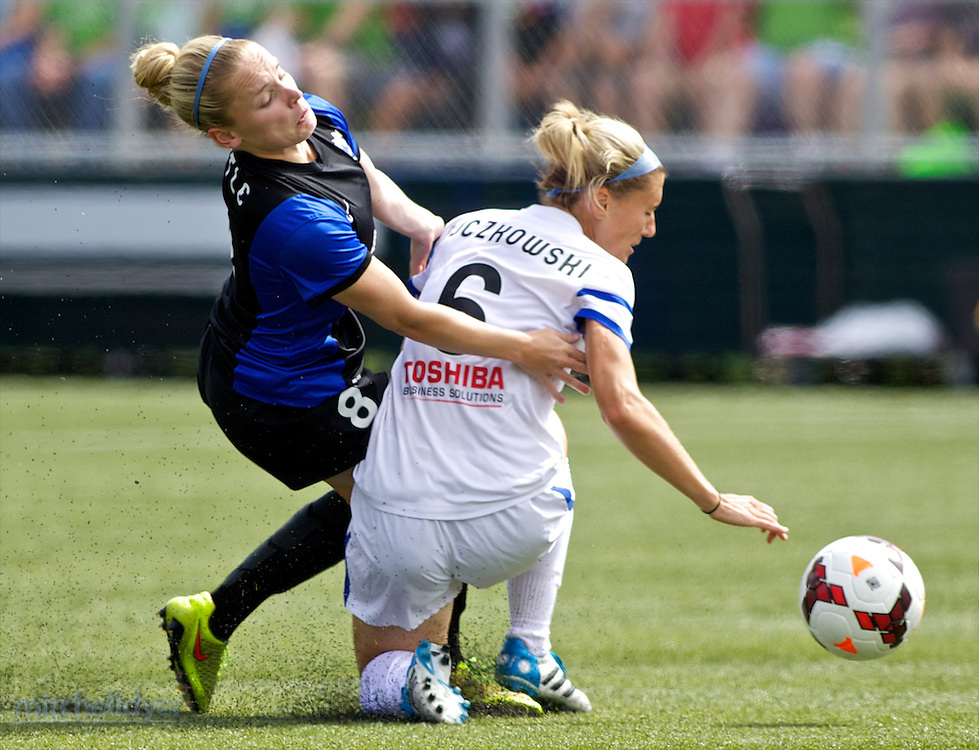 TUKWILA, WA - AUGUST 31: Kim Little #8 of Seattle Reign FC and Jen Bucowski #6 of FC Kansas City collide in the first half of of the National Women's Soccer League Championship on August 31, 2014 at Starfire Stadium in Tukwila, Washington.  (Photo by Craig Mitchelldyer/Getty Images) *** Local Caption *** Kim Little; Jen Bucowski