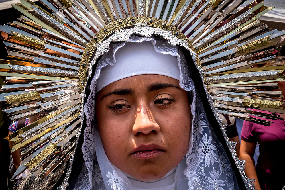 An actress playing the Virgin Mary stays in character for days during Saints Week, never smiling. Playing one of the major characters in the procession is seen as a great honor.