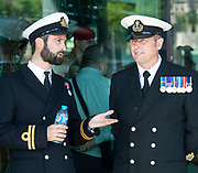 Naval Officers chat before the ceremony starts <br /> <br /> <br /> Armed Forces Day - City Hall ceremony pays tribute to British Armed Forces, London, Great Britain 25th June 2018 <br />  <br /> The Mayor of London and the London Assembly joined members of the British Armed Forces at City Hall today for a flag-raising ceremony to honour the courage and commitment of the Armed Forces community.<br /> The annual ceremony took place ahead of National Armed Forces Day, next Saturday, and was attended by members of the Forces as well as veterans, reserves, cadets and representatives from military charities. It is the 10th Armed Forces Day ceremony organised by the Mayor and London Assembly.<br /> <br /> The Mayor, Sadiq Khan and Chair of the London Assembly, Tony Arbour AM, joined senior military figures for the ceremony, which featured musical contributions from the Band of the Royal Yeomanry.<br />  <br /> Naval Commodore David Elford OBE, Army Colonel Victor Matthews OBE and Air Commodore David Prowse OBE from the Royal Air Force offered a joint military response.<br /> The Armed Forces flag was raised by Cadet Cpl Aaron Harmsworth and Cadet Charlotte McCarthy.<br /> <br /> Photograph by Elliott Franks