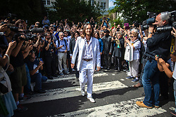 © Licensed to London News Pictures. 08/08/2019. London, UK. A Beatles tribute band 'Fab Four' recreate the famous album cover photograph at the zebra crossing outside the Abbey Road studios in north London. The Beatles were photographed for the Abbey Road album cover 50 years ago today by Iain Macmillan. Photo credit: Rob Pinney/LNP