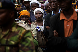Kenyans wait to board army trucks to return home at the Molo District Commissioner's Office. Four months after post election violence caused 300,000 Kenyans to leave their homes, the long process to resettle has begun. In Molo, a town in Kenya's Rift Valley where most of the violence occured, thousands of people returned to their homes with little or nothing to build upon.