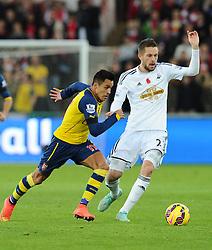 Arsenal's Alexis Sanchez battles for the ball with  Swansea City's Gylfi Sigurosson - Photo mandatory by-line: Joe Meredith/JMP - Mobile: 07966 386802 - 09/11/2014 - SPORT - Football - Swanswa - Liberty Stadium - Swansea City v Arsenal - Barclays Premier League
