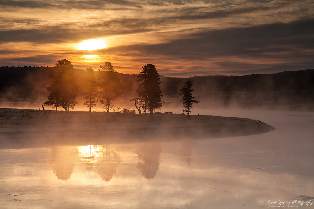 Steam rises over the water on a cold September morning in Yellowstone National Park