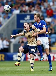 Leeds United's Ross McCormack battles with Leicester City's Andy King  - Photo mandatory by-line: Matt Bunn/JMP - Tel: Mobile: 07966 386802 11/08/2013 - SPORT - FOOTBALL - King Power Stadium - Leicester -  Leicester City v Leeds United - Sky Bet Championship