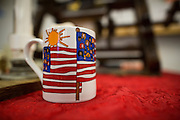 A patriotic coffee mug is displayed during the International Printing Museum's Ben Franklin's Colonial Assembly: A Museum On Wheels at Curtner Elementary School in Milpitas, California, on May 13, 2014. (Stan Olszewski/SOSKIphoto)