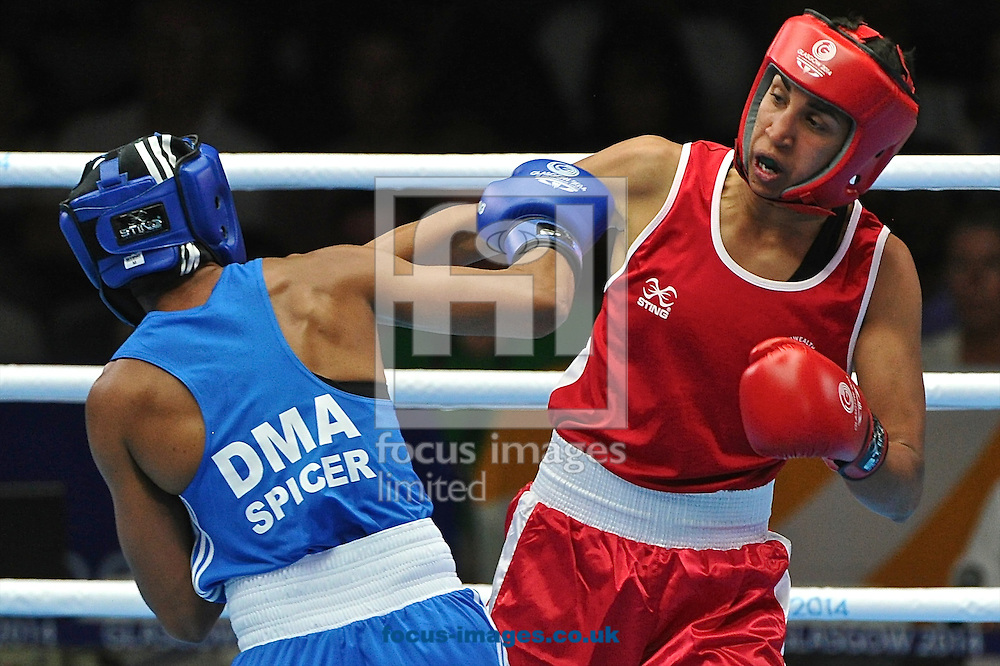 Alexis Pritchard of New Zealand (Red strip) and Valerian Spicer of Dominica (Blue strip) pictured during Boxing Day Five at SECC Precinct during Glasgow 2014 Commonwealth Games <br /> Picture by Ian Wadkins/Focus Images Ltd +44 7877 568959<br /> 29/07/2014