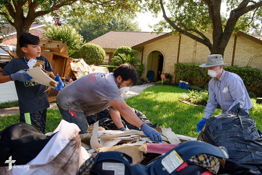 Eric Hollar (right), member at Memorial Lutheran Church, Katy, Texas, helps other volunteers clear debris from a home damaged by Hurricane Harvey at a home near the church on Friday, Sept. 1, 2017, in Katy. LCMS Communications/Erik M. Lunsford
