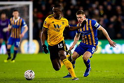 Willy Boly of Wolverhampton Wanderers takes on Greg Docherty of Shrewsbury Town - Mandatory by-line: Robbie Stephenson/JMP - 05/02/2019 - FOOTBALL - Molineux - Wolverhampton, England - Wolverhampton Wanderers v Shrewsbury Town - Emirates FA Cup fourth round replay