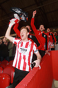 Kyle Storer leads the celebrations after the Vanarama National League match between Cheltenham Town and FC Halifax Town at Whaddon Road, Cheltenham, England on 16 April 2016. Photo by Antony Thompson.