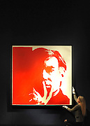 London News pictures. 11.02.2011. A woman holds a rediscovered self-portrait by Andy Warhol. The picture painted in 1967 which has been in a private collection since 1974 is expected to realise 3 million to 5 million pounds. A preview, today (Fri) of Christie's Auction House Post-War and Contemporary Art Evening Auction. The sale is expected to make a combined total of 46,246,000 to 66,447,000 when it is sold on 16th Feb 2011.. Picture Credit should read Stephen Simpson/LNP
