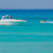 Different colors of the caribbean with yacht and waverunner. Isla Mujeres. Quintana Roo. Mexico.