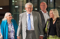 London, June 26th 2014. Entertainer and artist Rolf Harris leaves Southwark Crown Court with his wife Alwen, left and daughter Bindi after a sixth day of waiting for the jury's verdict on the 12 counts he faces of indecent assault against 4 girls aged 7- 16.