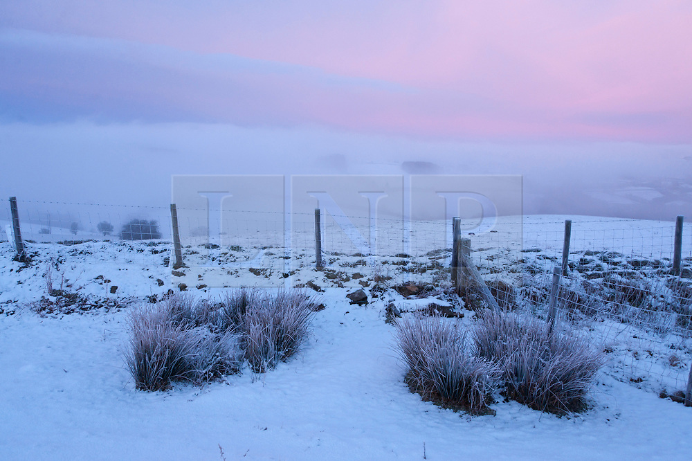 © Licensed to London News Pictures. 31/01/2019. Builth Wells, Powys, Wales, UK. A bitterly cold wintry landscape at dawn on the Mynydd Epynt range near Builth Wells in Powys, Wales, UK where temperatures dropped dramatically overnight to minus seven degrees centigrade (temperature certified by photographer) <br />  credit: Graham M. Lawrence/LNP