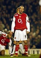 Fotball<br /> England 2004/2005<br /> Foto: SBI/Digitalsport<br /> NORWAY ONLY<br /> <br /> Arsenal v Manchester United<br /> Barclays Premiership. 01/02/2005<br /> <br /> Arsenal and Freddie Ljungberg have no luck against Manchester United.