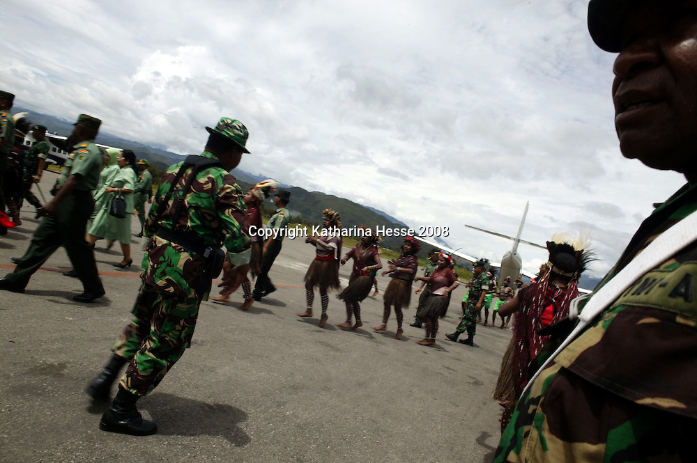 WAMENA, APRIL 30 2007: an ethnic tribe dances at the arrival of  a military attache at Wamena airport.. Logging is one of the major causes of environmental destruction in West Papua. As Indonesia's own forest resources decline, it has turned its attention to West Papua. Indonesia's forest practices generally have little or no attention paid to the environmental impact of logging. Many of the indigenous people of West Papua are threatened as vast tracts of land have been granted as concessions to timber companies, a practice which is having severe social and physical consequences. . The island of New Guinea is one of the most biologically diverse in the world. There are species of flora and fauna in common with Australia, such as some marsupials, the bird of paradise and eucalyptus trees. Numerous species, unique to the island, are threatened by logging and other development projects. . Second only to the Amazon, the island of New Guinea has one of the largest tracts of tropical rainforest left in the world. West Papua's forests, rich in bio-diversity, account for approximately 34.6 million hectares or 24 per cent of Indonesia's total forested area of 143 million hectares. Over 27.6 million hectares of forest in West Papua have been designated as production forest.