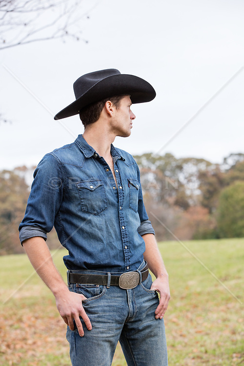 chiseled All American cowboy outdoors