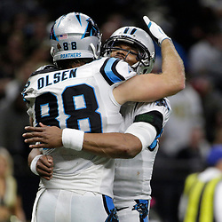 Jan 7, 2018; New Orleans, LA, USA; Carolina Panthers tight end Greg Olsen (88) celebrates with quarterback Cam Newton (1) after catching a pass for a touchdown against the New Orleans Saints during the fourth quarter in the NFC Wild Card playoff football game at Mercedes-Benz Superdome. Mandatory Credit: Derick E. Hingle-USA TODAY Sports