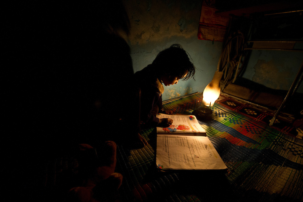 Many children from poor backgrounds in India have to do their homework in dark houses without electricity.