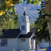 St. Nicholas Russian Orthodox Church with Chgach Mountains in backgroun, Eklutna, Alaska