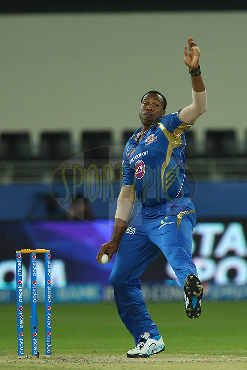 Kieron Pollard of the Mumbai Indians during match 20 of the Pepsi Indian Premier League Season 2014 between the Mumbai Indians and the Sunrisers Hyderabad held at the Dubai International Stadium, Dubai, United Arab Emirates on the 30th April 2014<br /> <br /> Photo by Ron Gaunt / IPL / SPORTZPICS