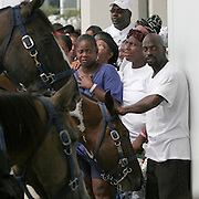 HOUSTON - SEPTEMBER 8:  Mounted police hold back evacuees in line to aquire Red Cross debit cards at the Reliant Center in Houston Thursday, September 8, 2005. The card has a $2000 credit to help evacuees.<br />