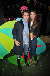 LAURA JACKSON and ENO POLO President of the Alpargartas Group/Havalanas at a party to celebrate the global launch of the Iconic Brazilian lifestyle brand Havaianas Wellies range held at Selfridges, Oxford Street, London on 14th April 2011.