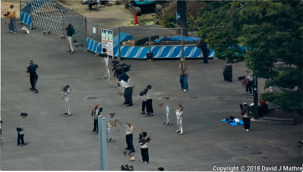 Early Morning Strech and Exercise at Niagara Falls in Shinjuku Chuo Park in Tokyo. Composite of 7 mages taken with a Nikon 1 V3 camera and 70-300 mm VR lens from my hotel room on the 20th floor in the Keio Plaza hotel (aprox. 400 meters distance).<br /> Photoshop, Statistics, Minimum.